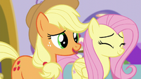Applejack compliments Rarity's hardwork while Fluttershy nods her head S5E14