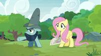 Big Daddy McColt gesturing toward the ponies S7E5