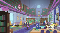 Friendship students in the library S8E15