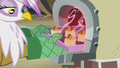 Gilda pulling scones out of the oven S5E8.png
