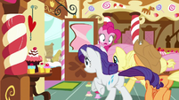 Rarity, Fluttershy, and AJ run toward the door S8E2