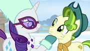 Rarity with hoof under Pistachio's chin MLPBGE