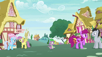Spike walking through Ponyville S7E15