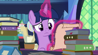Twilight Sparkle looking at a spell scroll S7E26
