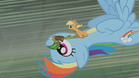 Applejack and Rainbow flying toward Zecora's hut S1E09