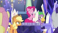 Pinkie Pie grinning; Applejack smirking S9E14