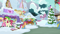 Ponies around town hall at Hearth's Warming MLPBGE