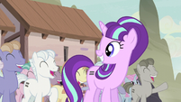Starlight smiling at the cheering equalized ponies S5E02