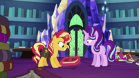 Sunset Shimmer picks up the journal with magic EGS3