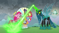 Chrysalis blasting her magic at Pinkie S9E25