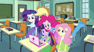 Pinkie Pie playing a video EG