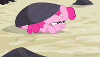 Pinkie hides under a bigger rock S5E1