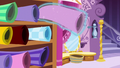 Roll of pink fabric floats off the shelf S6E6.png