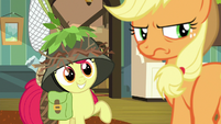 Apple Bloom grins; Applejack scowls S9E10