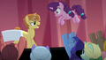 Backup dancers throw Sugar Belle onto the stage S7E8.png
