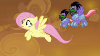 Fluttershy being chased by Sombrafied guards S9E2
