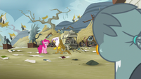 Gabby looking at Pinkie Pie and Gilda S6E19