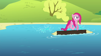 Pinkie Pie on a log floating on a lake S4E18