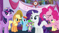 Pinkie looking at Rarity's hoof S5E14