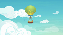 Rainbow and hot-air balloon fly through the sky S8E5