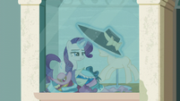 Rarity puts another hat on the mannequin S6E9