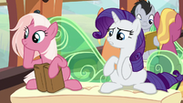 Rarity sits down next to Earth mare S9E26