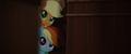 Applejack and Rainbow peek through crates MLPTM.png