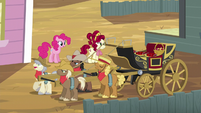 Cherry walks towards the carriage S5E11