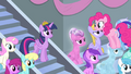 Pinkie Pie standing on Crystal Pony's head S4E24.png