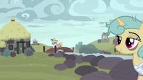 Ponies walking through the village S7E26