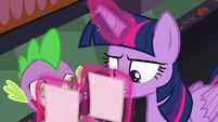 Twilight Sparkle looking at her notes S8E1