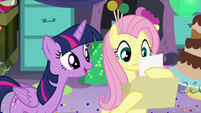 "Fluttershy reads ""Twilight Sparkle likes vanilla ice cream, red balloons, dancing..."" S5E11"