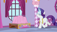 Rarity trots to something covered in pink sheet S9E26