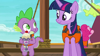 Spike smiling goofily at Twilight Sparkle S6E22