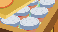 Zap apple jam jars inside the crate S6E23