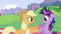 Applejack pushing Twilight Sparkle's hoof S2E03