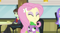 Fluttershy hugging puppy Spike in the cafeteria EG2.png