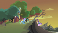 Starlight, Thorax, and Trixie walking toward the hive S6E26