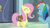 Rainbow looking suspiciously at Fluttershy S9E21