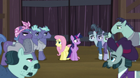 Twilight and Fluttershy surrounded by McColts S5E23