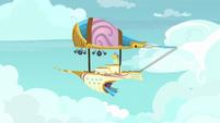 Zeppelin flying through the sky S7E22