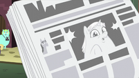 Incidental Pony on newspaper front page S5E16