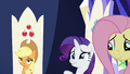 Rarity holding in her laughter S6E1.png