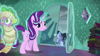 Starlight walking to the door while levitating Spike S6E2