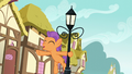 Tender Taps swinging from a lamppost S6E4.png