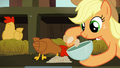 Applejack collects eggs while brown chicken eats S6E10.png