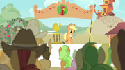 Applejack holding the microphone S4E14