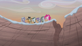 Pie family looking over the cliff S5E20.png
