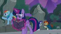 Twilight continues to read Star Swirl's writings S7E25