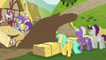 Derpy's cart kicks up mud puddle S6E14.png